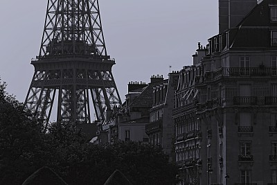Eiffel Tower and french architecture from Les Invalides quarter at sunset – Paris, France