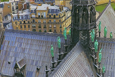 Notre Dame Cathedral and French roofs architecture from above at sunset – Paris, France