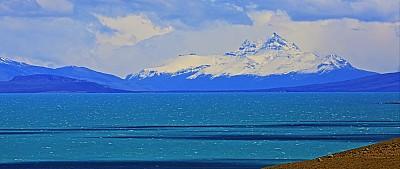 Lake Argentina shore and snowcapped mountains at dramatic sky – El Calafate, Patagonia Argentina