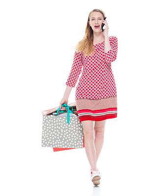 女性,18岁到19岁,青年人,衣服,红色裙子,舒服,在活动中,背景分离,从容态度,拿着
