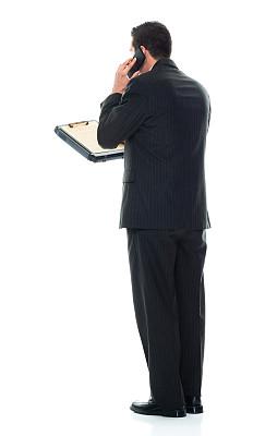 拿着,写字板,智能手机,男商人,白色背景,正装,男性,白色人种,衣服,站
