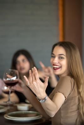 Eski?ehir Turkey Beautiful young woman and friends  drink wine at restaurant