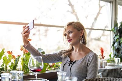 Eski?ehir Turkey Beautiful young woman taken selfie restaurant