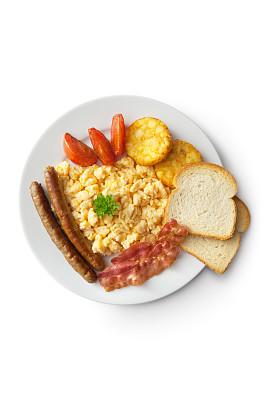 西红柿,摊鸡蛋,鸡蛋,香肠,熏猪肉,吐司面包,薯饼,正上方视角,无人,餐桌