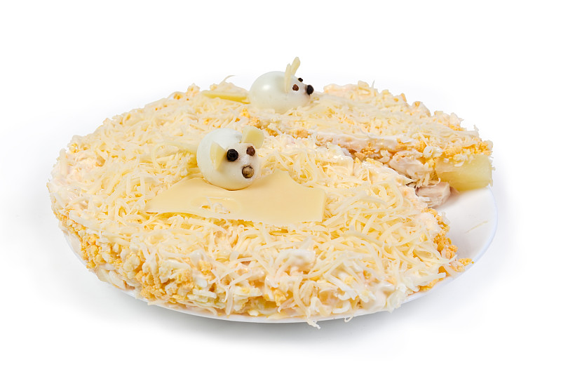 Сheese,salad,,decorated,with,small,figures,rats,made,from,boiled,quail,eggs,,as,a,symbol,of,Year,of,the,Rat,on,the,white,dish,on,a,white,background,close-up,in,selective,focus