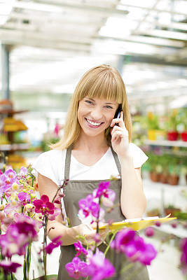 植物馆,花卉商,女性,垂直画幅,兰花,业主,仅一朵花,仅成年人,青年人,植物学