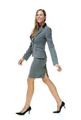 女商人,彩色运动茄克,垂直画幅,注视镜头,高跟鞋,白人,仅成年人,长发,青年人,仅一个青年女人