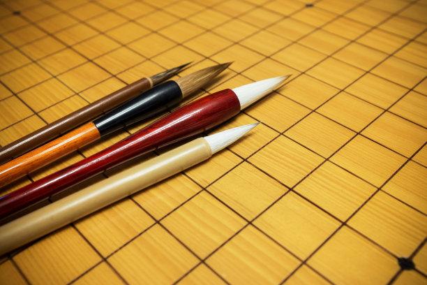 棋盘游戏,书法,在活动中,写字器具,汉字,手工艺设备,智慧,中文,褐色,围棋