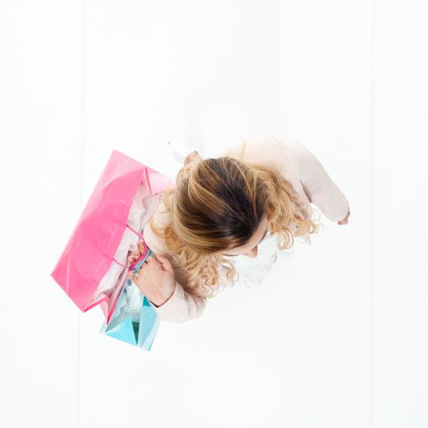 拿着,购物袋,女商人,快乐,休闲活动,高视角,男商人,经理,仅成年人,青年人